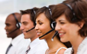 Group of happy call center employees with headset